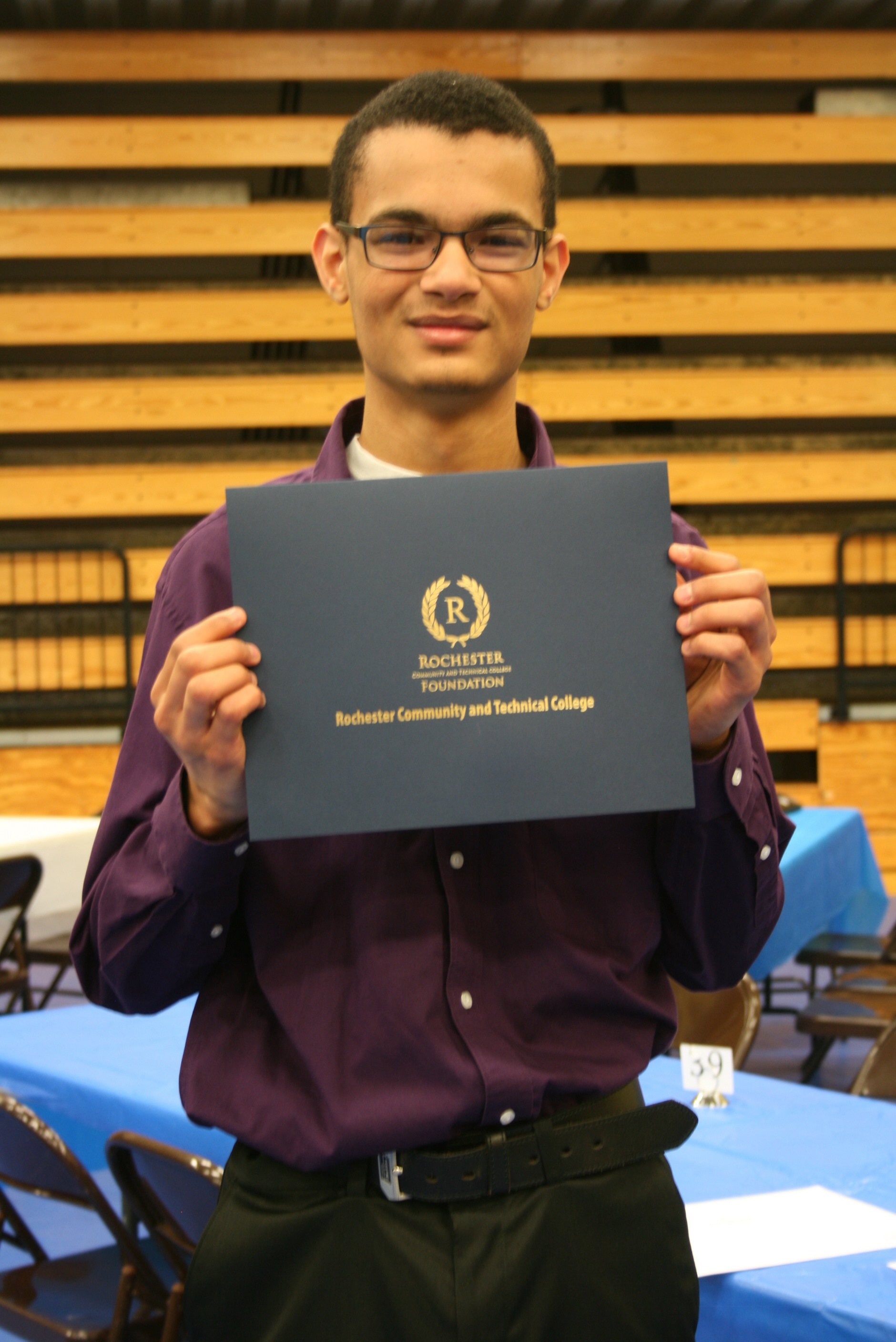Image of Student with Certificate