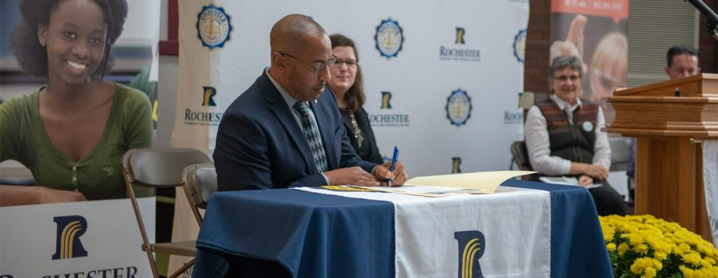 President Boyd Signs Compassion Charter